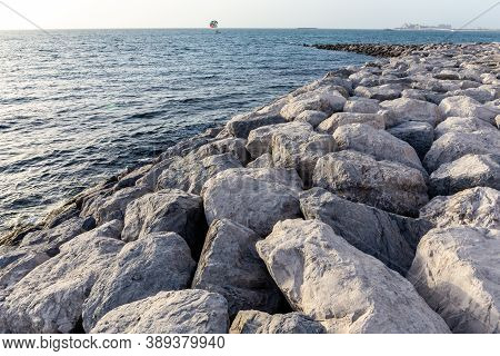Jetty Made Of Large Stones And Rocks Extending Into The Sea On Bluewaters Island In Dubai. Parasaili
