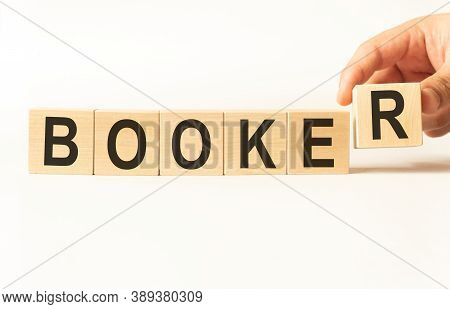 Word Booker. Wooden Small Cubes With Letters Isolated On White Background With Copy Space Available.