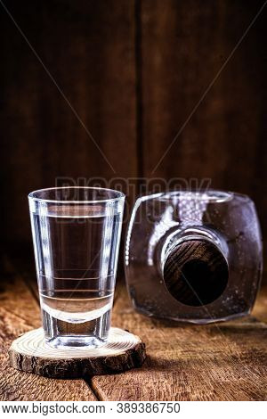 Glass And Bottle Of Strong Distilled Alcohol, With Space For Text, Black Background. Image For Pug O