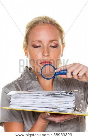 a tax auditor from the tax office at work. controller scanned documents poster