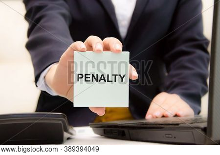 The Text Penalty Is Written On A Blue Sticker Held By A Girl. The Judge Is Obliged To Pay A Fine Or