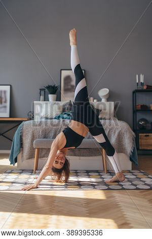 Three Legged Dog Pose. Fit Woman Doing Stretching Yoga Exercise