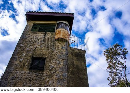 Birdwatching Tower Stands Out Against The Blue Sky In Castegnero, Vicenza, Veneto, Italy