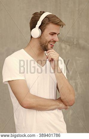 Audio Fun. Happy Guy Listen To Audio In Headphones. Handsome Man Enjoy Audio Learning. Audio Course.