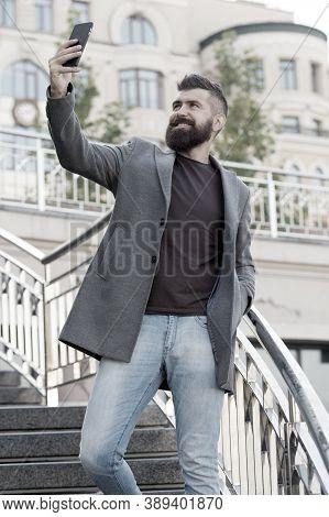 Hand Selfie. Bearded Man Take Selfie With Smartphone Outdoor. Businessman Smile To Selfie Camera In