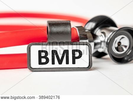 Bmp Basic Metabolic Panel Lettering On A Business Card With A Holder, Next To The Red Stethoscope. M