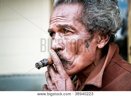 SANTA CLARA,CUBA-JAN 10:Unidentified Cubans smoking cigar on Jan  10. 2010.Santa Clara,Cuba.Cubans of all ages are actively smoking cigars.All production in Cuba is controlled by the Cuban government