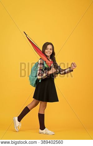 Only Happy When It Rains. Happy Girl Go To School. Little Girl Carry Stick Umbrella For Rainy Weathe
