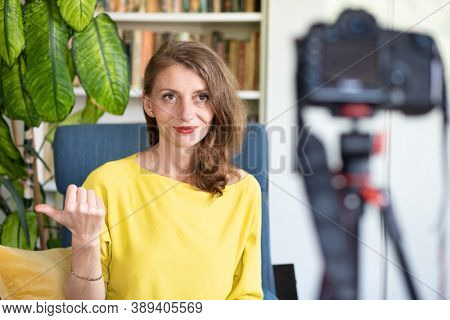 teacher or vlogger recording a lesson on camera online learning