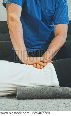 Therapist Massaging Woman's Back At Her House. Medical Homecare.