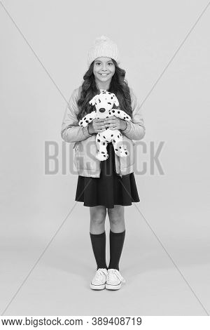 Endless Friendship. Happy Child Hold Soft Toy Yellow Background. Small Girl Smile With Toy Friend. F