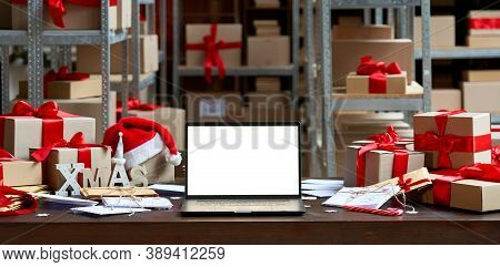 Laptop Computer With White Blank Empty Mock Up Screen On Merry Christmas Table With Presents Gifts B