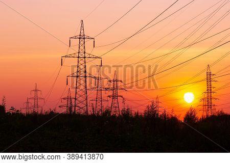 Electric Power Transmission Lines. High Voltage Post. Industrial Landscape. Electricity Pylon At Sun