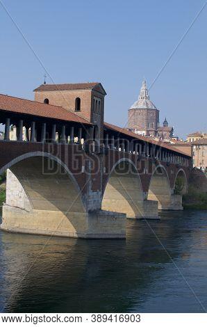 View Of The Ponte Coperto (or Ponte Vecchio) Bridge With The Cathedral Church In The Background Loca