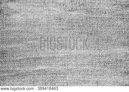 Black Denim Fabric Texture. Black Jeans Denim Cloth Fragment As A Background Texture Composition