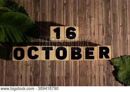 October 16.october 16 On Wooden Cubes On A Wooden Background.autumn.calendar For October.