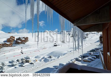 Icicles hanging on the balcony of a ski resort in the winter Alps