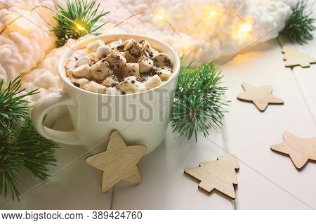 Christmas Drink Hot Cocoa With Marshmallows Surrounded By Winter Decorations On White Wooden Table.