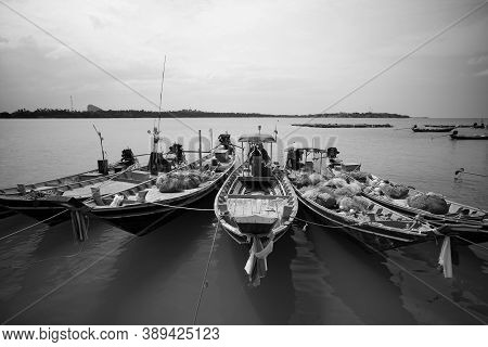 Longtail Fishing Boats At Fishing Village In Thailand Black And White