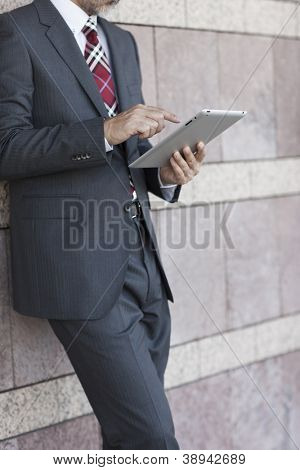 The businessman who operates a tablet PC poster