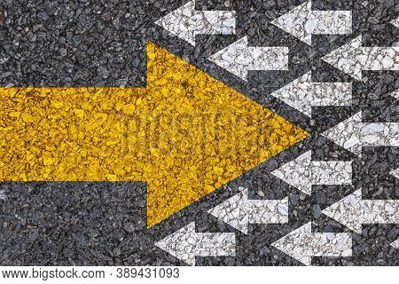 Different Thinking And Business And Technology Disruption Concept. Yellow Big Arrow Opposite  Direct