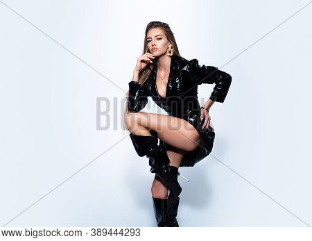 Fetish Fashion. Sexy Woman Legs In High Black Boots. Gorgeous Seductive Model Girl