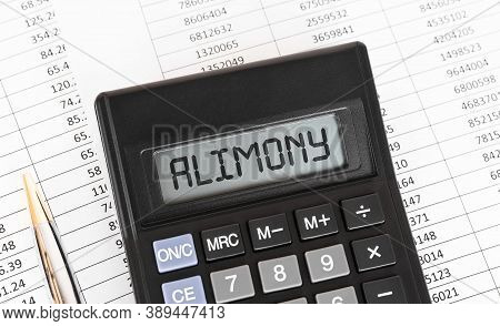 Calculator With The Word Alimony On The Display