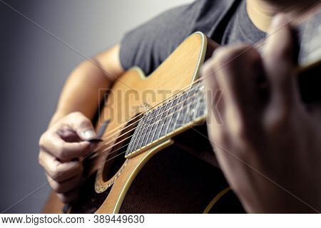 Musicians Are Playing Acoustic Guitar.