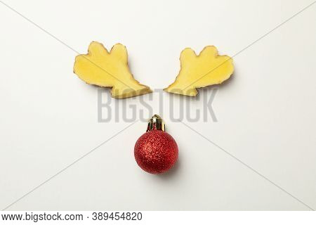 Deer Antlers Made Of Ginger And Bauble On White Background