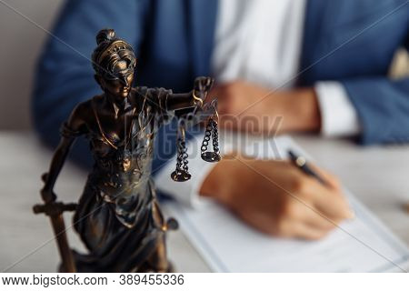 Lawyer Office. Statue Of Justice With Scales Close-up And Lawyer. Legal Law, Advice And Justice Conc