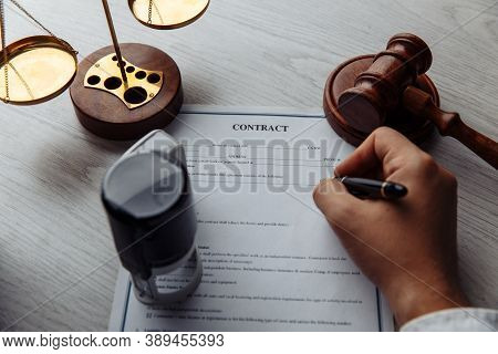 Notary Man Signing The Document Close-up. Notary Public Tools