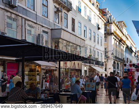 Lisbon, Portugal - October 01, 2019:  People Walking And Sitting In The Outdoor Restaurant At Rua Au