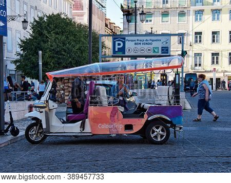 Lisbon, Portugal - October 01, 2019:  Tuk Tuk Waiting For Tourists Or Passengers At The Figueira Pla
