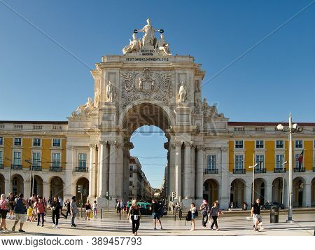 Lisbon, Portugal - October 01, 2019:  People Walking In Front Of  The Rua Augusta Arch Which Is A Tr