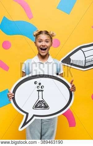 Schoolchild Holding Speech Bubble With Test Tube Illustration Near Paper Elements And Pencil On Yell