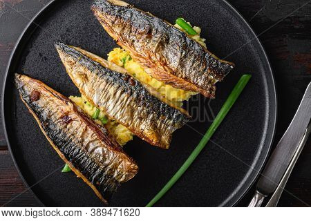 Dish Of Marinated Mackerel With Mashed Potatoes On Dark Wooden Table, Flat Lay