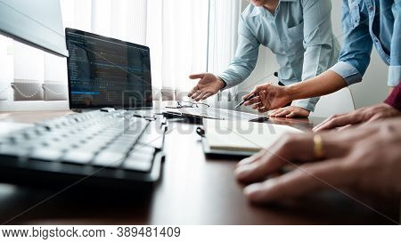 Team Of Programmer Working To Find Solution To Problem And Coding Technologies In A Software Develop