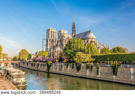 Paris, Notre Dame Cathedral With Boats On Seine In France