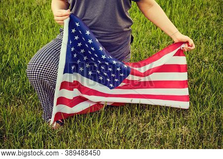 Protest In The Us Park Grass, Woman Kneel. Usa Flag, Kneeling On Green Background, Lifestyle Close U