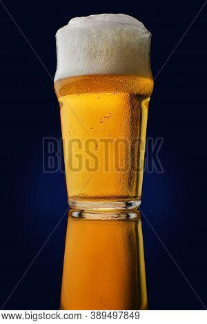 Beer. Cold Craft Light Beer In A Glass With Water Drops. Pint Of Beer Close Up On Dark Background. B