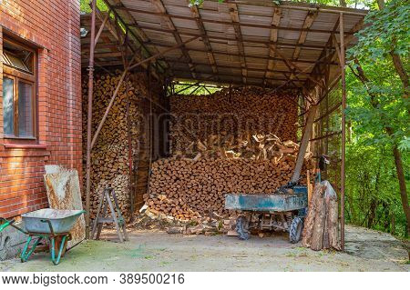 A Stack Of Firewood. Wooden Pile With Stocked Firewood For Winter Heating.