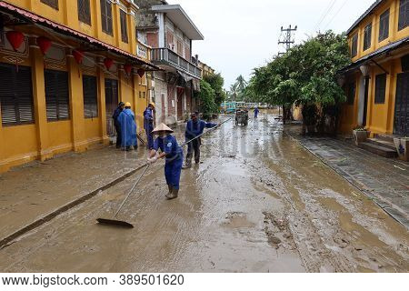 Hoi An, Vietnam, October 13, 2020: Workers Clean A Street After Severe Flooding Due To A Tropical St