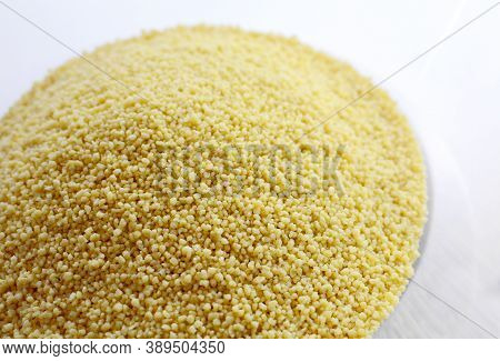 Closeup Of Raw Uncooked Cous Cous Heap In The Bowl.