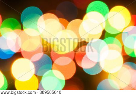 Blurred background, festive blurred multicolor bokeh background. Holiday blurred glowing color lights with sparkles, blurred bright abstract bokeh, holiday defocused color light, blurred background