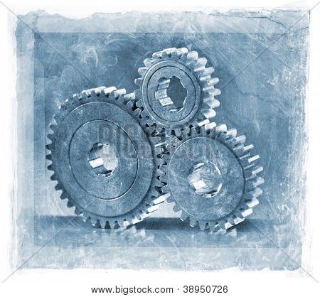grainy and gritty manipulated photo of three cog gears.