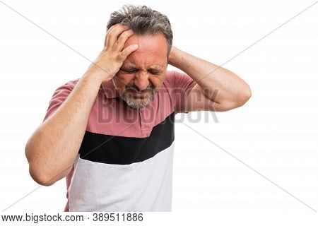 Man Model Wearing Casual Colourful Summer Attire Holding Head With Hands Making Sick Pain Expression