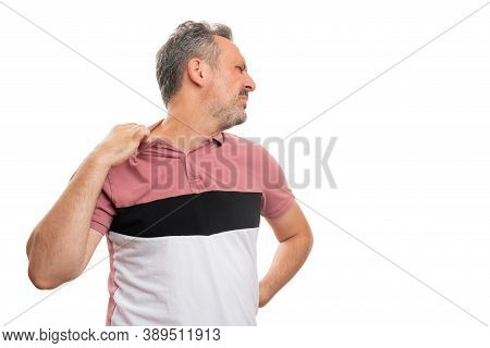Adult Male Model Pulling Casual Summer Tshirt Collar As Too Hot High Temperature Weather Gesture Iso