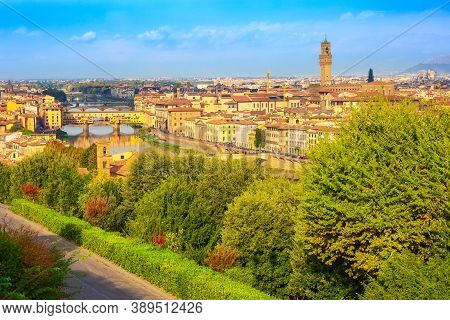 Florence, Italy City View With Palazzo Vecchio Tower, Houses And Ponte Vecchio Across The River Arno