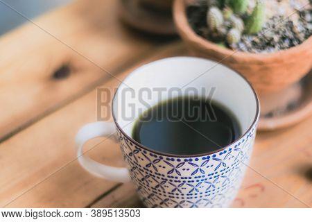 Selective Focus Of Chlorophyll Water Healthy Drink In Vintage Cup.