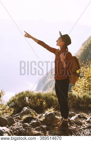 Hiker Girl With Backpack Relaxing On Top Of Mountain.